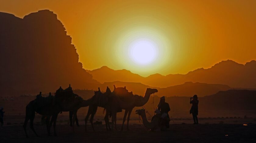 A searing sunset adds more magic to the lunar-like Wadi Rum desert. Norma Meyer photo