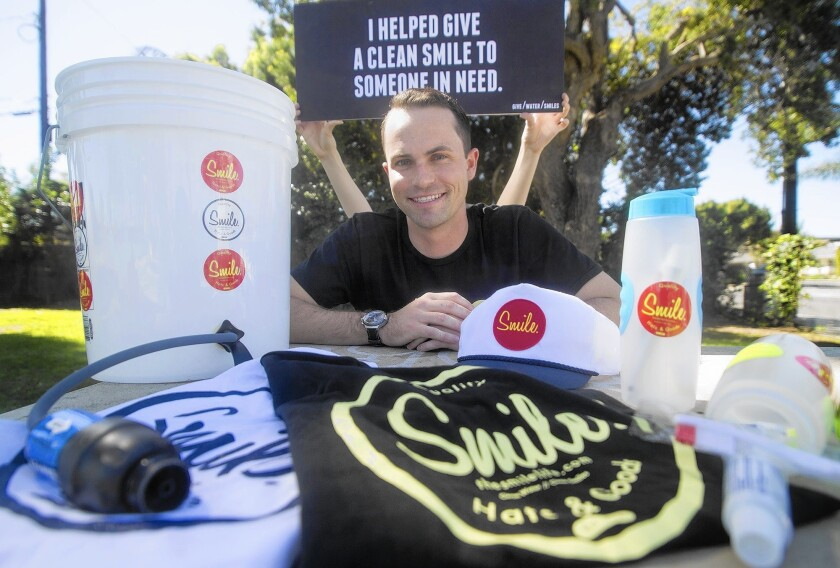 "Kyle Lawrence, 24, a Newport Harbor volleyball alum, founded Costa Mesa-based ""The Smile Life,"" a company selling hats and T-shirts with sales benefiting the homeless."