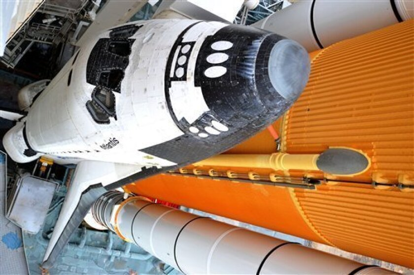 Space Shuttle Atlantis is seen on the pad at the Kennedy Space Center at Cape Canaveral, Fla. , Thursday July 7, 2011.  Atlantis and a crew of four are scheduled to launch on Friday, July 8, on the 135th and final space shuttle launch for NASA. (AP Photo/Stan Honda, Pool)