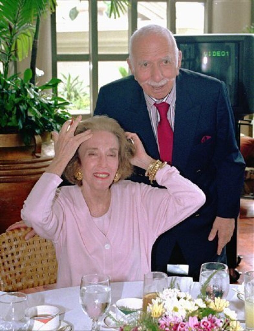 FILE - In this April 25, 1997 file photo, Helen Gurley-Brown, editor-in-cheif of the Cosmopolitan International Editions, prepares for a photo session with her husband Hollywood film producer David Brown Friday,at a hotel in suburban Makati City. Film and theater producer David Brown died Monday, Feb. 1, 2010 at his Manhattan home. He was 93. (AP Photo/Pat Roque, File)