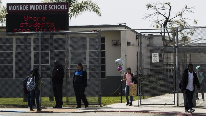 INGLEWOOD, CA - APRIL 5, 2018: Students leave Albert F. Monroe Magnet School at the end of the scho