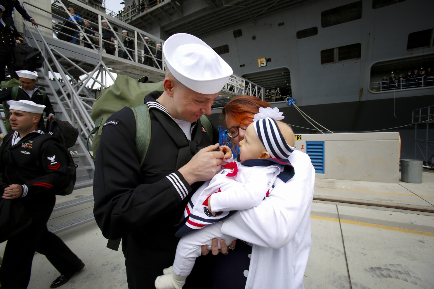 Hugs, smiles and tears as carrier Abraham Lincoln arrives in San Diego from 10-month deployment