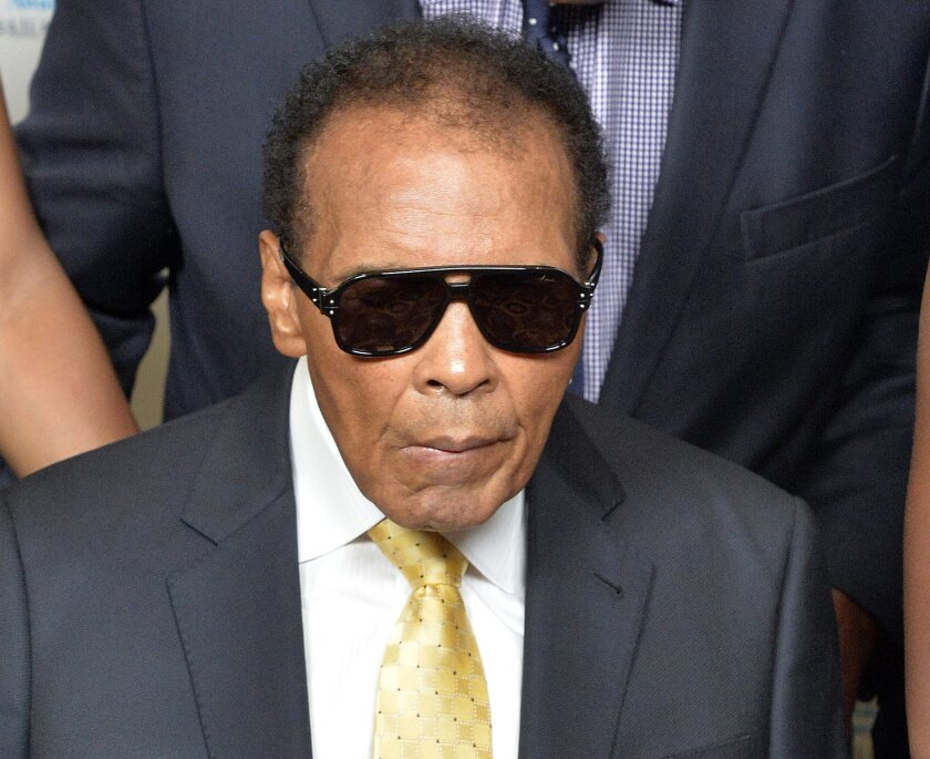 FILE - In this Sept. 27, 2014, file photo, Muhammad Ali is shown before the Ali Humanitarian Awards ceremony in Louisville, Ky. Ali was back in the hospital Thursday Jan. 15, 2015 for follow-up care related to a severe urinary tract infection, his second stint in the hospital in the last four weeks
