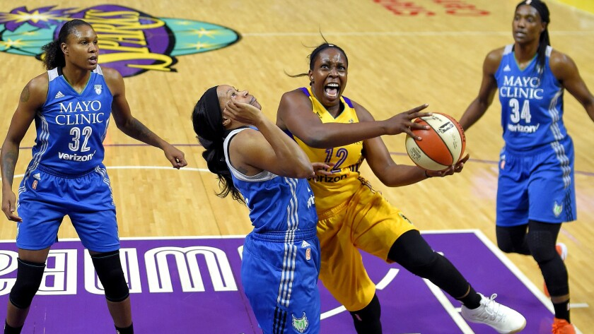 Sparks guard Chelsea Gray, driving to the basket against Lynx guard Jia Perkins, scored 14 points in the Game 3 victory.
