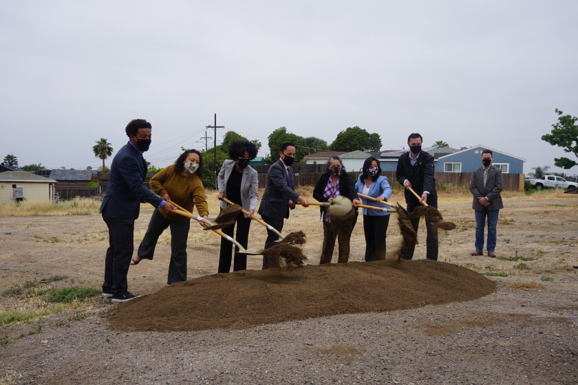 San Diego elected officials, city staff members and residents holding shovels in Valencia Park on May 11, 2021.