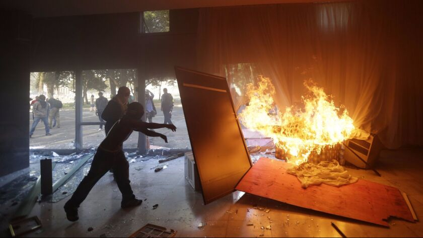 Demonstrators attack facilities of the Agriculture Ministry in Brasilia. A number of government buil