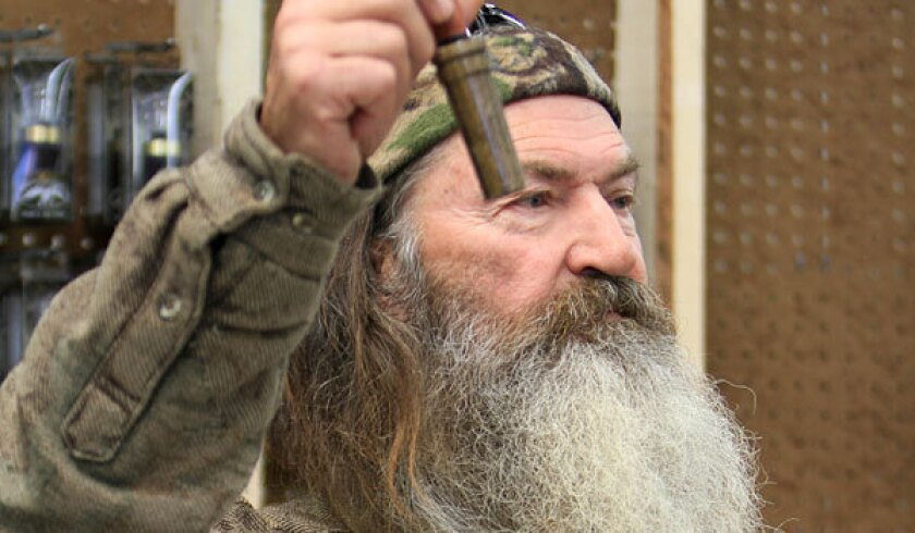 "Phil Robertson was suspended from the A&E show ""Duck Dynasty"" after expressing controversial views on civil rights and gays in a magazine interview."