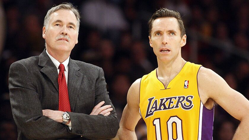 Mike D'Antoni, then Lakers coach, talks with point guard Steve Nash on Jan. 1, 2013.
