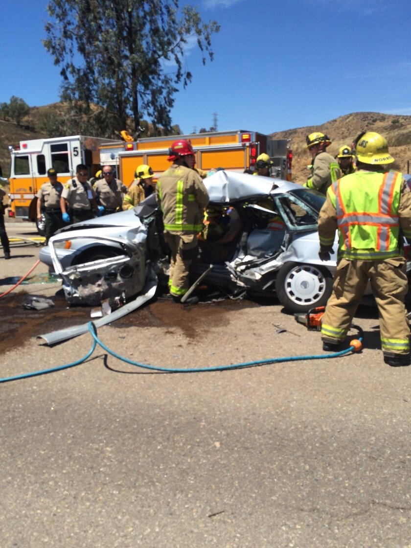 Two students in this sedan were injured, one fatally. / Santee Fire Department photo