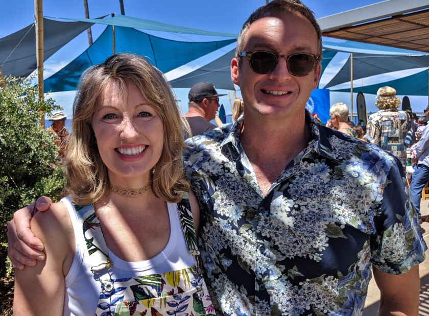 Dr. Catriona Jamieson and biotech executive John Hood, seen on Sunday, Aug. 18, at the 26th Annual Luau and Legends of Surfing Invitational. The fundraiser benefits UCSD Moores Cancer Center.