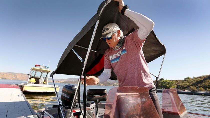 CASTAIC, CA - JUNE 15, 2017 - Dan Curtis who has been fishing at Castaic Lake since 1985 prepares hi