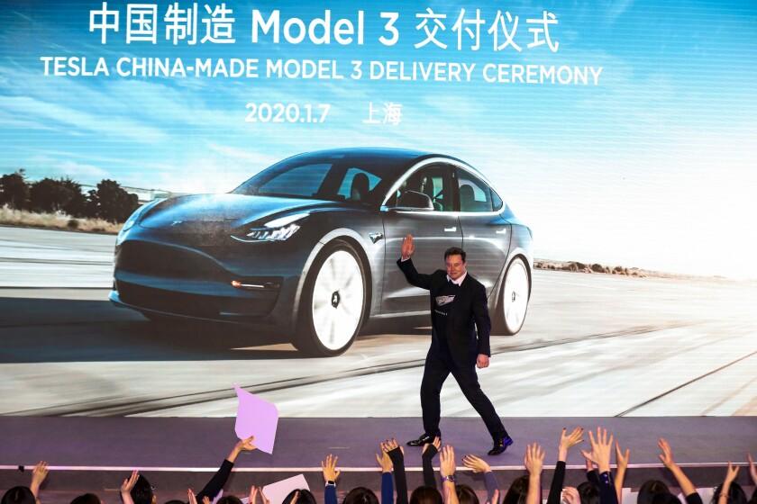 Tesla CEO Elon Musk greets the crowd at a Tesla China-made Model 3 delivery ceremony in Shanghai on Jan. 7.