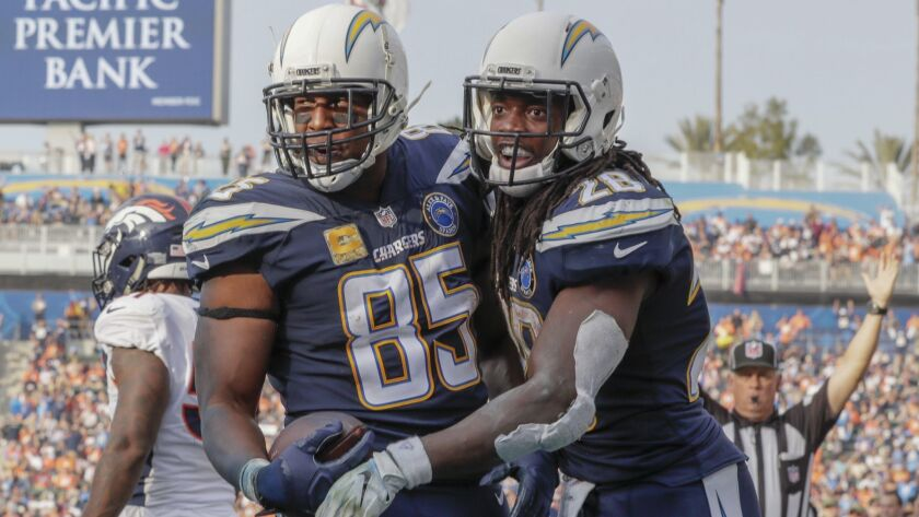 Chargers tight end Antonio Gates is congratulated by Melvin Gordon after catching a six-yard touchdown pass in the third quarter against the Broncos.