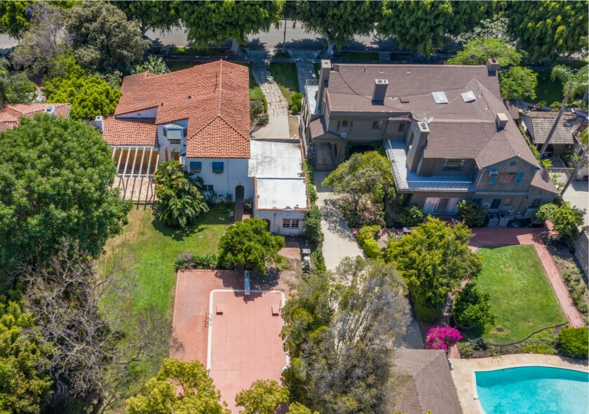 Aerial view of the two side-by-side estates: a 1930s Traditional-style home, right, and 1920s Spanish-style home.
