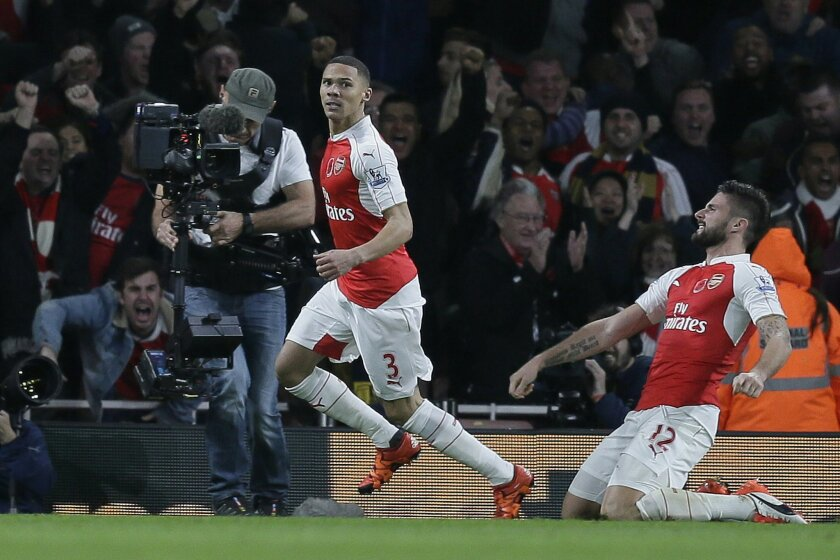 Arsenal's Kieran Gibbs, left, celebrates after scoring a goal,with Arsenal's Olivier Giroud during the English Premier League soccer match between Arsenal and Tottenham Hotspur at the Emirates Stadium in London, Sunday Nov. 8, 2015. (AP Photo/Tim Ireland)