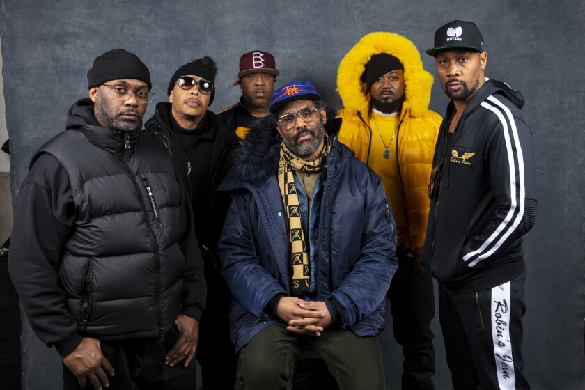 """""""Wu-Tang Clan: Of Mics and Men"""" director Sacha Jenkins, seated center, with Wu-Tang Clan members, standing from left, Masta Killa, U-God, Cappadonna, Ghostface and RZA. Photographed at the L.A. Times Photo and Video Studio at the 2019 Sundance Film Festival, in Park City, Utah."""