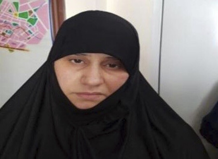 Undated handout photo made available by unnamed government sources showing a woman identified as Asma Fawzi Muhammad al-Qubaysi, a wife of the slain leader of the Islamic State group Abu Bakr al-Baghdadi. Turkey has captured a wife of the slain leader of the Islamic State group, Abu Bakr al-Baghdadi, Turkish President Recep Tayyip Erdogan said Wednesday Nov. 6, 2019. A senior Turkish official said the woman was among a group of 11 Islamic State suspects detained in a police operation in Turkey's Hatay province, near the border with Syria, on June 2, 2018.(Handout via AP)