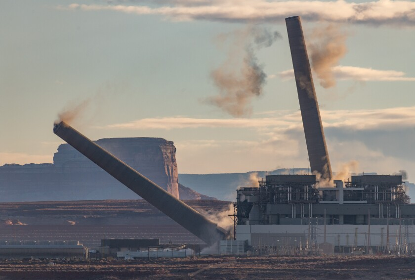 Two  smokestacks topple at Navajo Generating Station outside Page, Ariz.