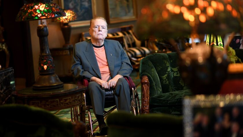 Larry Flynt sits in a wheelchair