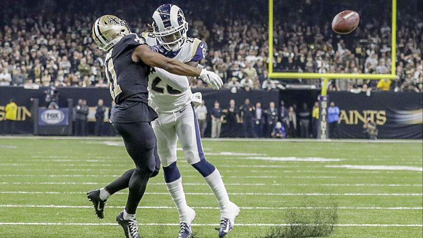 Rams cornerback Nickell Robey-Coleman seems to deliver an early hit to  New Orleans Saints receiver Tommylee Lewis late in the fourth quarter, thwarting a potential game-winning drive in the NFC Championship at the Superdome last season.