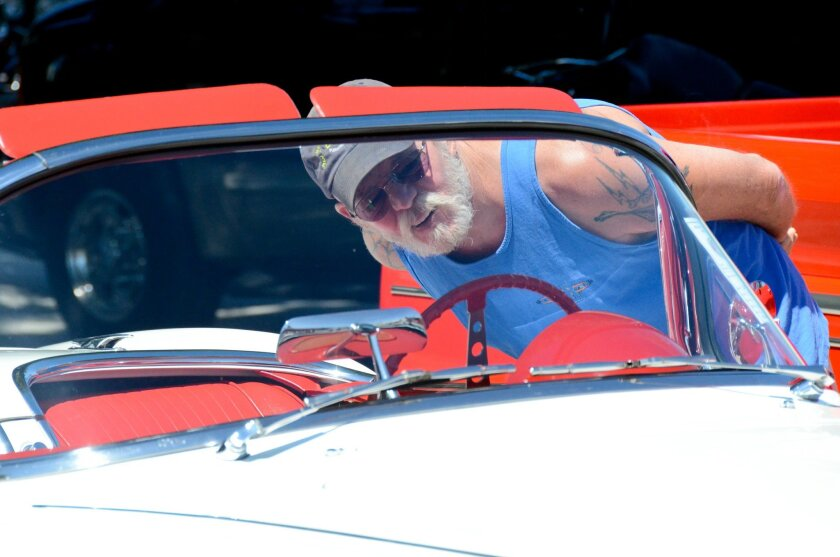 Temecula resident Jon Solter, 57, took some time to inspect some of the classic cars parked amid the hot rods.
