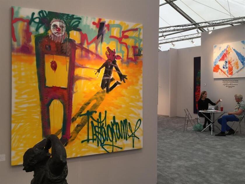 """La obra """"Instagram"""" del grafitero disidente cubano Danilo Maldonado, """"El Sexto"""", expuesta hoy, miércoles 30 de noviembre 2016, en el espacio de la galería danesa Agerled en la feria Art Concept en Miami, Florida. """"El Sexto"""", que está detenido desde el 26 de noviembre por una pintada sobre la muerte de Fidel Castro, no llegó a Miami para la Semana del Arte, pero dos de sus obras, """"Hambre"""" e """"Instagram"""", le representan en una de las ferias artísticas de la ciudad. EFE"""