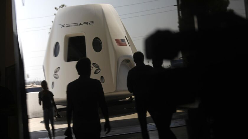 A mock-up of SpaceX's Crew Dragon spacecraft is on display Aug. 13 at the company's Hawthorne headquarters.