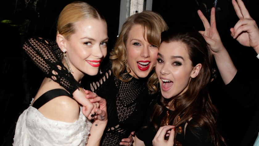 "Taylor Swift, center, with two of her besties, Jaime King, left, and Hailee Steinfeld. The friends can celebrate now that ""bestie"" has been added to the dictionary."