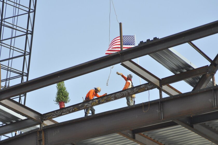 A ceremonial beam was raised at San Marcos High School.