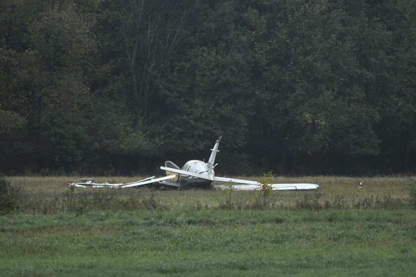 The scene just west of Capital Region International Airport where a small plane crashed Thursday, Oct. 3, 2019. Three are dead, three were taken to Sparrow hospital in Lansing with critical injuries. (Matthew Dae Smith/Lansing State Journal via AP)