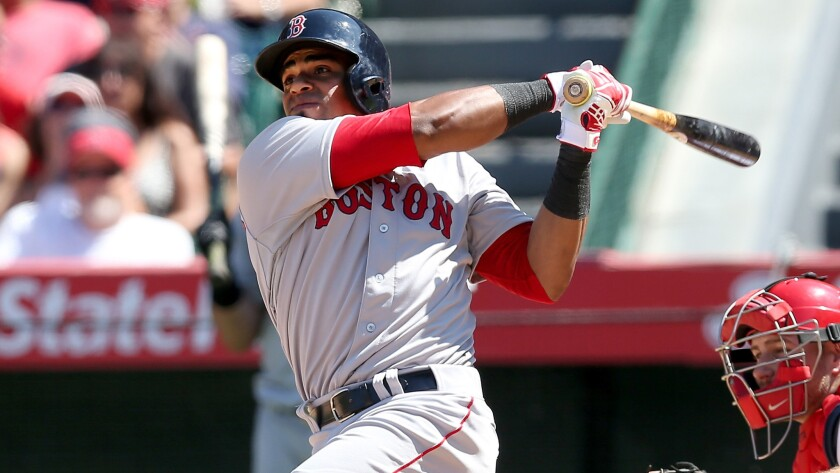 Boston Red Sox outfielder Yoenis Cespedes hits a three-run home run against the Angels on Aug. 10.
