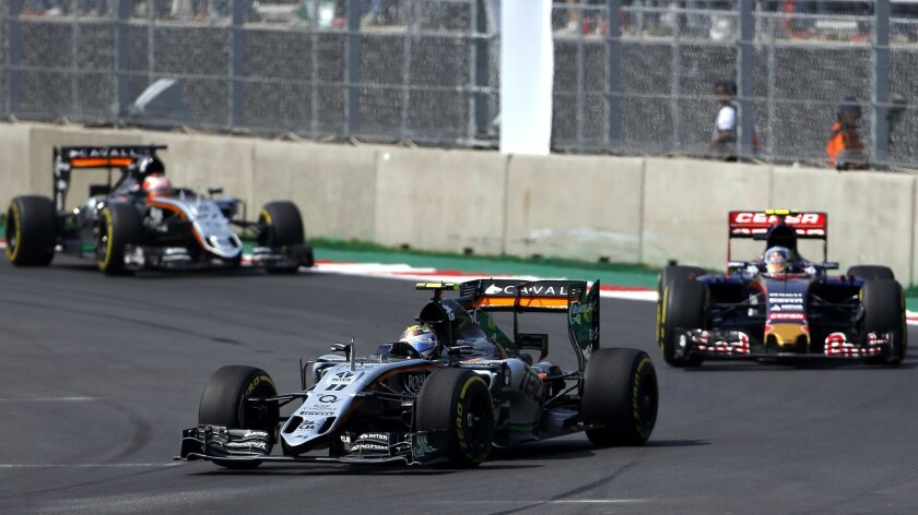 Force India driver Sergio Perez of Mexico leads ove Toro Rosso driver Carlos Sainz of Spain and teammate Nico Hulkenberg of Germany his car during the Formula One Mexico Grand Prix auto race at the Hermanos Rodriguez racetrack in Mexico City, Sunday, Nov. 1, 2015. (AP Photo/Eduardo Verdugo)