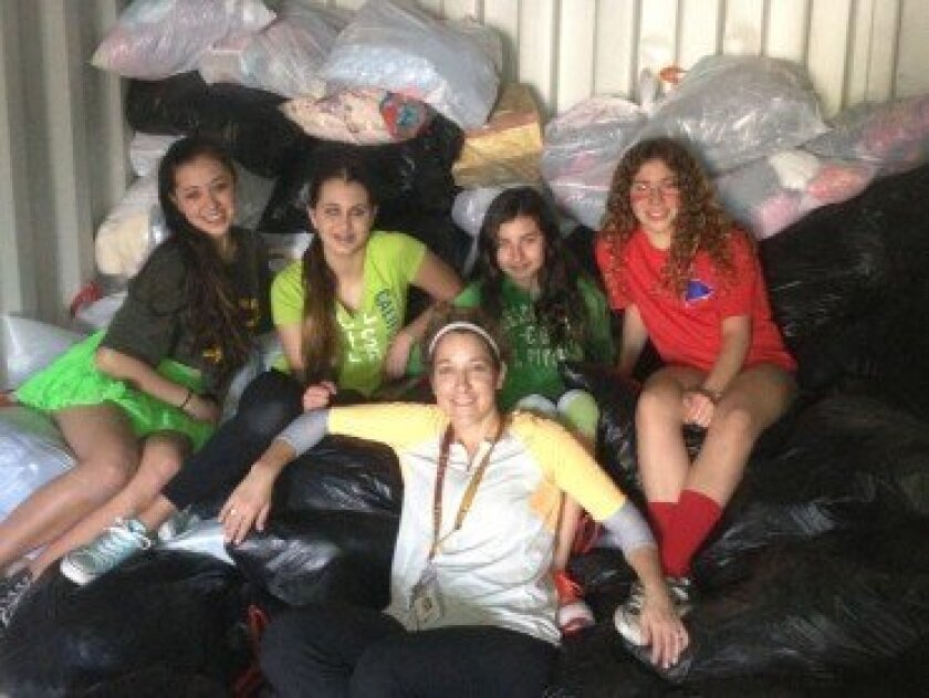 SDJA teacher Amy Civin and her eighth grade class are looking for used clothing donations for their Project Rwanda drive. Courtesy photo