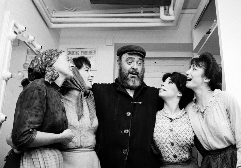 "Zero Mostel, center, with Maria Karnilova, from left, Tanya Everett, Julia Migenes and Joanna Merlin, stars of ""Fiddler on the Roof"" in 1964."