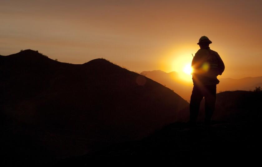 A San Bernardino firefighter at the Mills fire in June 2013