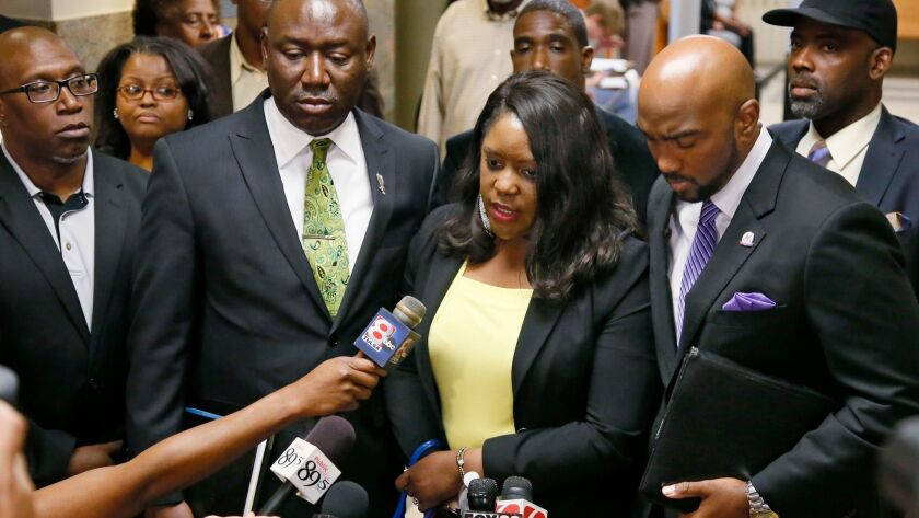 Tiffany Crutcher, center, the twin sister of Terence Crutcher, talks with the media as she leaves th