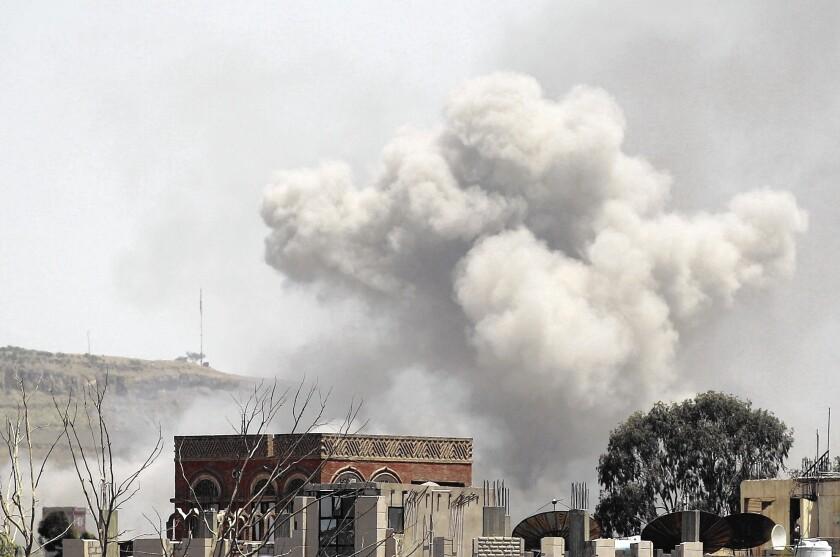 Smoke rises above the Alhva camp, east of the Yemeni capital, Sana, after airstrikes by a Saudi-led alliance.