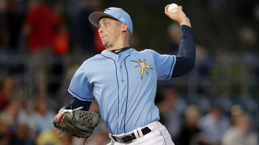Tampa Bay Rays starting pitcher Blake Snell throws during the first inning of the team's spring training baseball game against the Minnesota Twins in Port Charlotte, Fla., Thursday, Feb. 28, 2019.