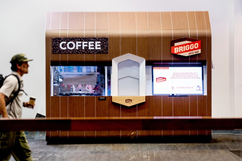 A traveler passes a Briggo coffee vending machine at San Francisco International Airport.