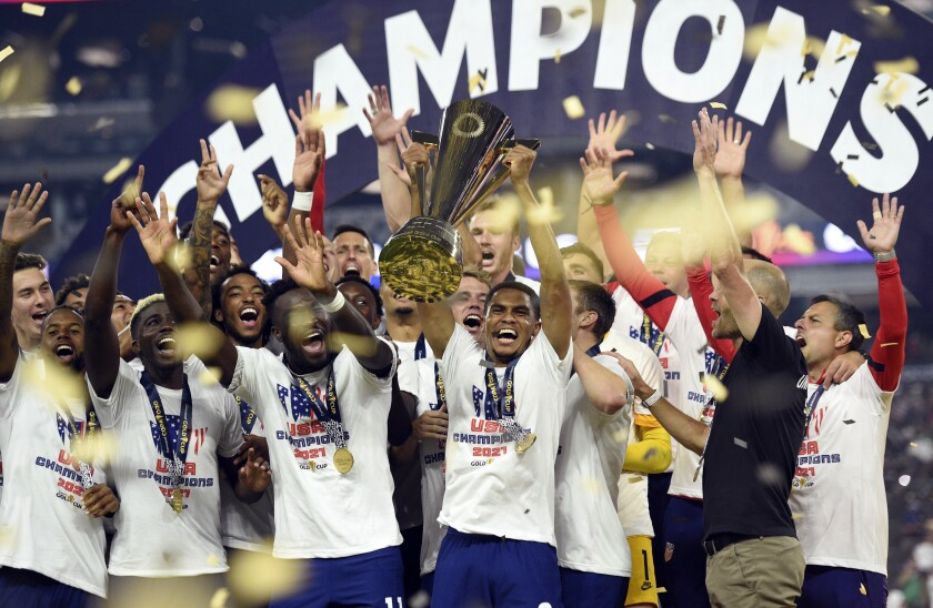 United States celebrate their extra-time victory over Mexico in the CONCACAF Gold Cup final soccer match Sunday