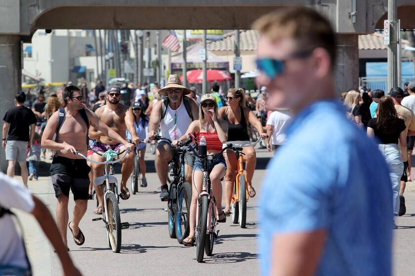 Crowds enjoy the sun on Labor Day in Huntington Beach.