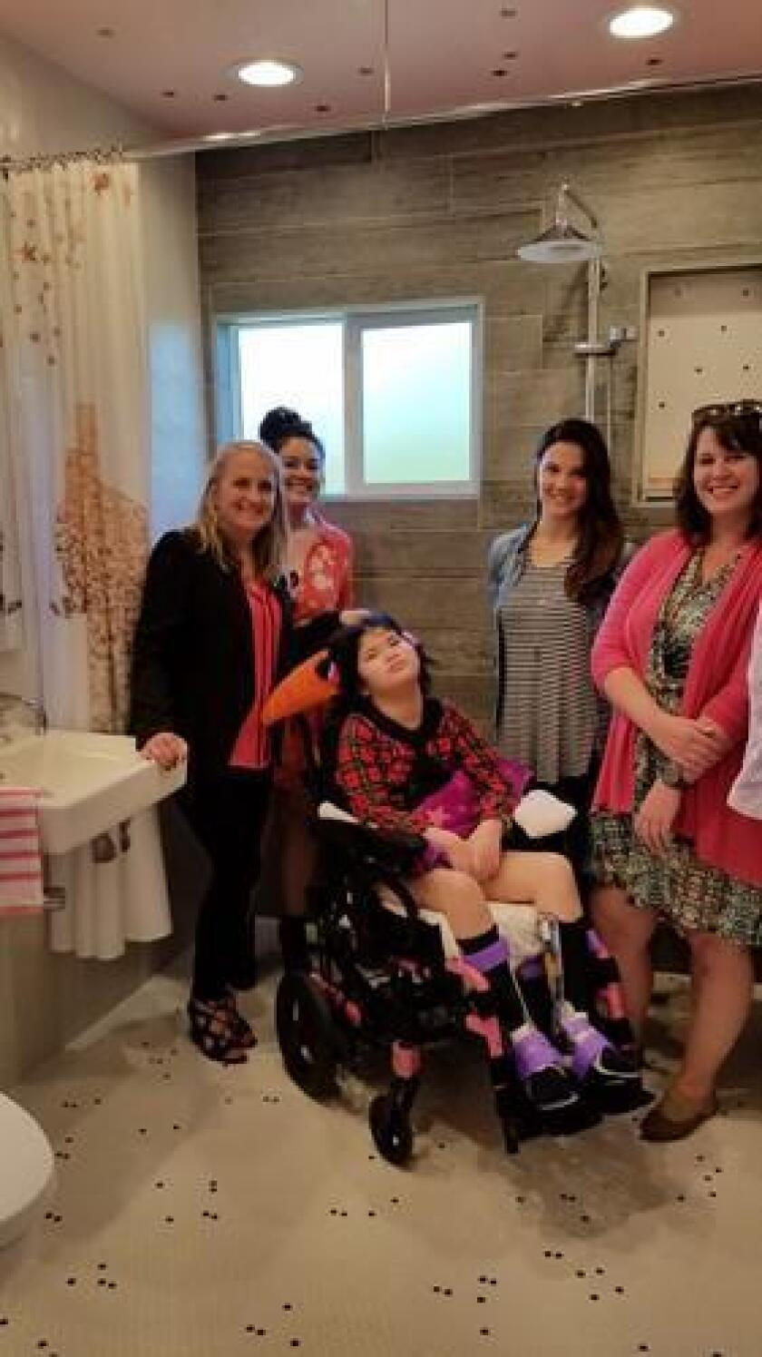 Theresa with the JRD team in her new wheelchair-accesible bathroom