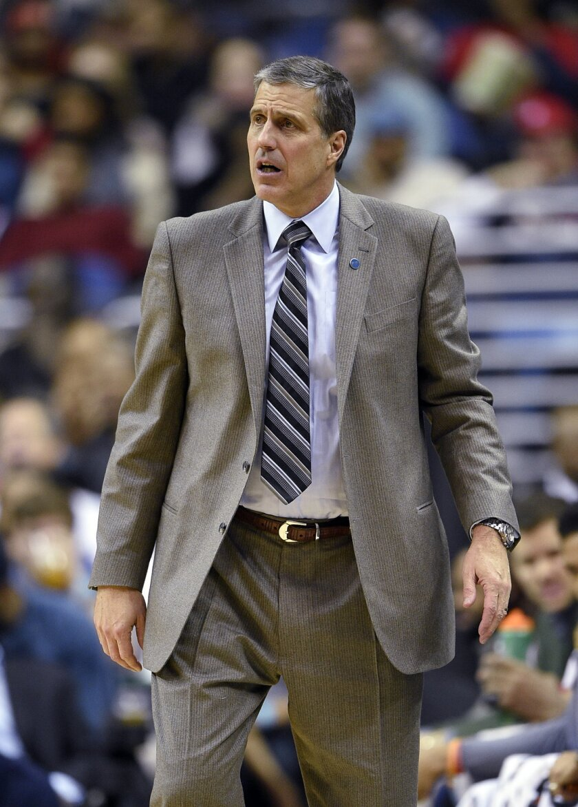 Washington Wizards coach Randy Wittman watches during the second half of the team's NBA basketball game against the Denver Nuggets, Thursday, Jan. 28, 2016, in Washington. The Nuggets won 117-113. (AP Photo/Nick Wass)