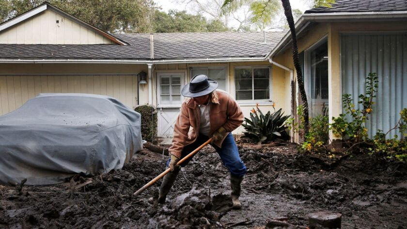 MONTECITO, CA-JANUARY 15, 2018: Mark Vance shovels mud away from his house on Olive Mill Road in Mon