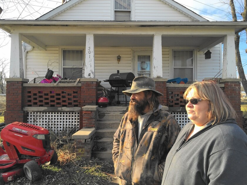 Jim and Kim Hanning inspect the flood damage at their home in Union, Mo.