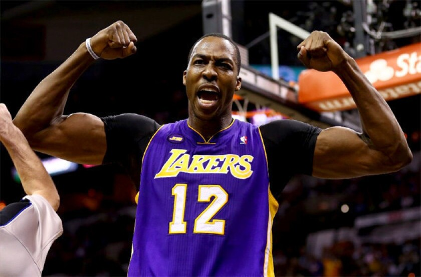 Lakers' Dwight Howard flexes after being fouled during a game against the San Antonio Spurs.