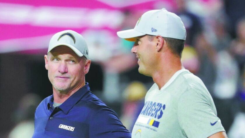 Chargers offensive coordinator Ken Whisenhunt talks with quarterback Philip Rivers during an exhibition game in August in Glendale, Ariz.