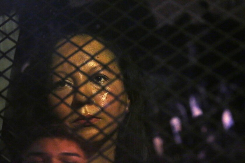 Guadalupe Garcia de Rayos is locked in a van that is stopped in the street by protesters outside an Immigration and Customs Enforcement facility Feb. 8 in Phoenix.