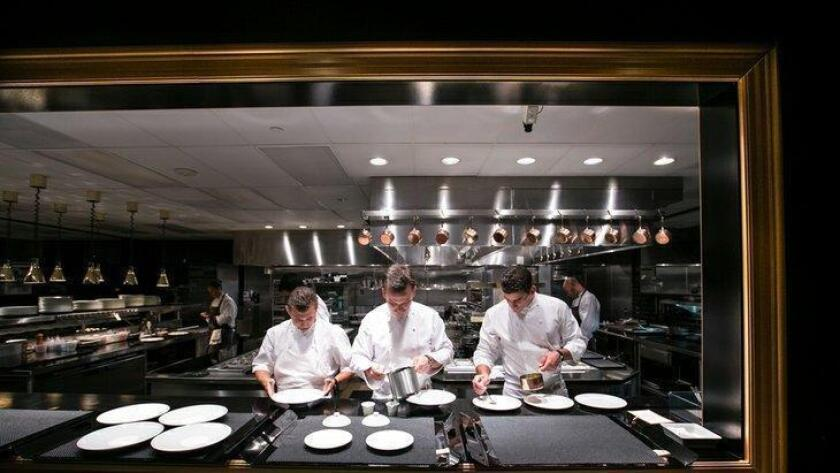 Addison executive chef William Bradley, center, was nominated Wednesday for his third James Beard award. (/ courtesy photo)