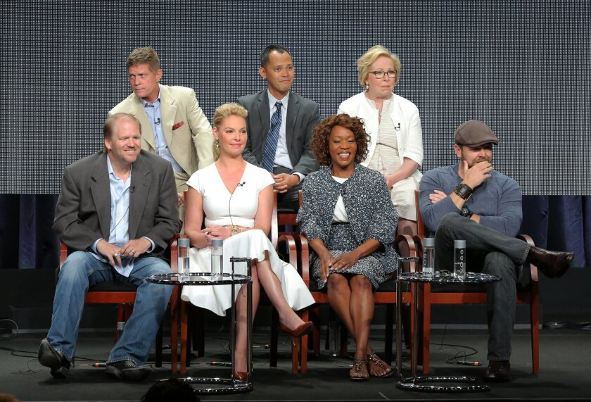 """This image released by NBC shows, back row from left, executive producers Bob Simonds, Rodney Faraon, Nancy Heigl, and front row from left, executive producers Ed Bernero, Katherine Heigl, actress Alfre Woodard and executive producer Joe Carnahan at the """"State of Affairs"""" panel at the NBC 2014 Summer TCA on Sunday, July 13, 2014, in Beverly Hills, Calif. (AP Photo/NBC, Chris Haston)"""
